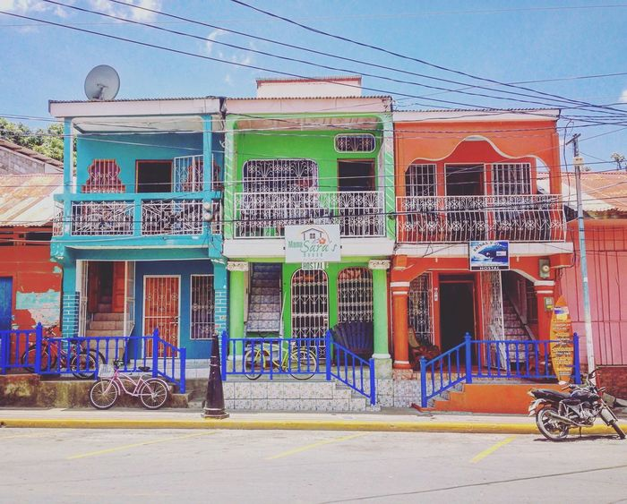 True Colors True Colours Of Life Life In Technicolor Moto Bycicles Hostel Colorful Buildings Rowhouses San Juan Del Sur , Nicaragua Happy Colors Upclose Street Photography