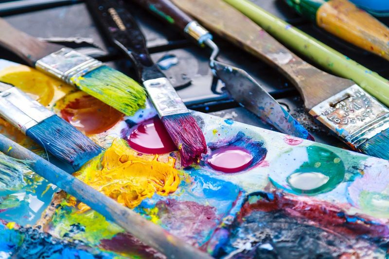 Close-up of paintbrushes and palette