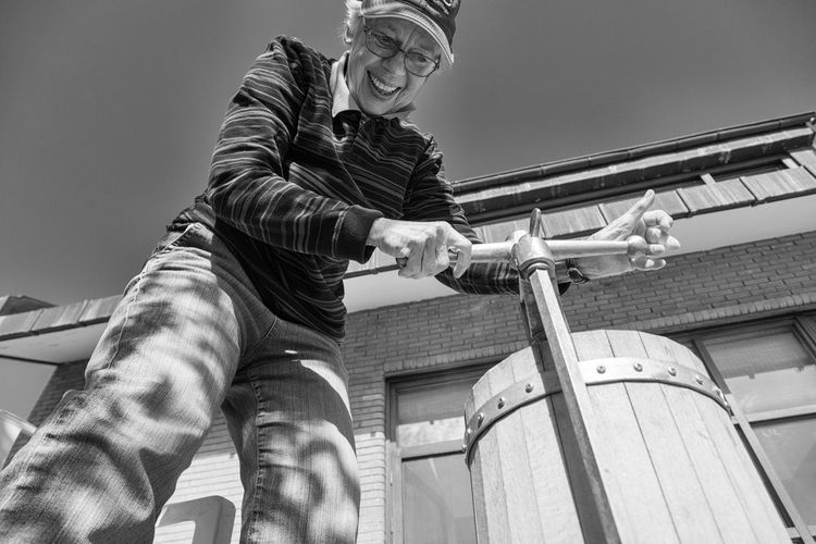 woman making pekmez, a boiled down fruit syrup Black And White Day Low Angle View One Person Outdoors Pekmez Pekmez Yapimi Portrait Real People The Portraitist - 2017 EyeEm Awards Turkey Woman Work