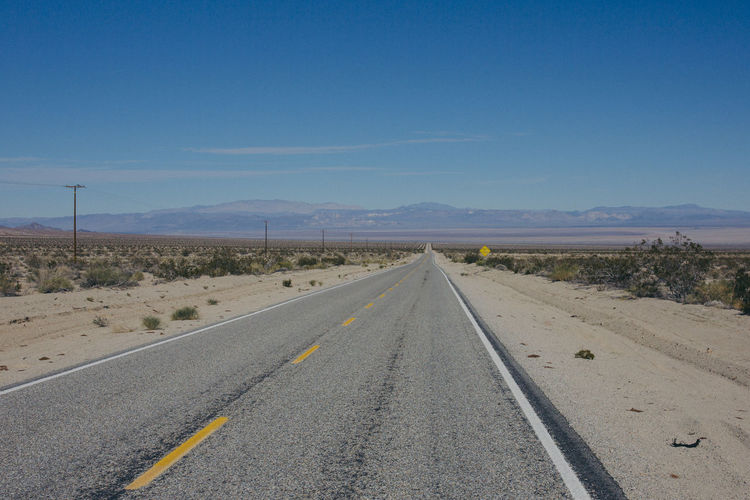 Arid Climate Blue Clear Sky Day Desert Landscape Nature No People Outdoors Road Sky The Way Forward Transportation Neighborhood Map