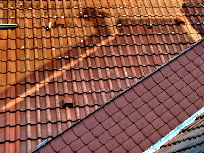 Arrow Sign Day Full Frame Light And Shadow No People Outdoors Pattern Roof Tiles Variety Of Tiles Turn Left Left Turn Abstract Photography This Is The View From My Kitchen Window ... EyeEm Ready   The Graphic City The Architect - 2018 EyeEm Awards