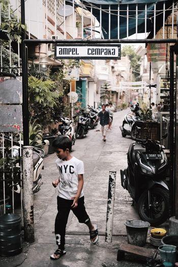 Rear view of men on street in city