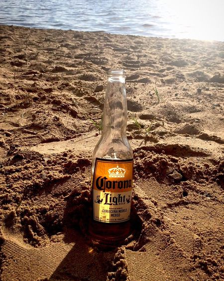Somewhere on a beach Beer On The Beach Corona Light Sand Water Tranquil Scene Outdoors Relaxing Day No People