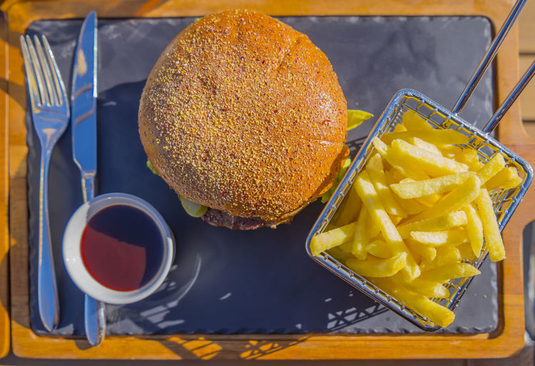 Hamburger de Luxe Bread Burger Close-up Fast Food Food Food And Drink French Fries Freshness Hamburger Healthy Eating High Angle View Meal No People Outdoors Ready-to-eat Sandwich Sauce Snack Still Life Table Take Out Food Temptation Tray Wellbeing Yellow