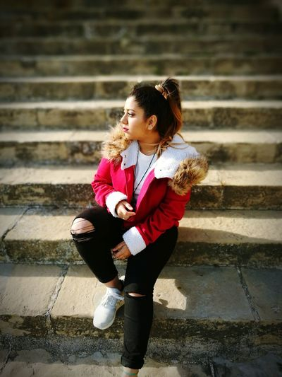 Steps Staircase Steps And Staircases One Person Young Adult Outdoors Day La Seu _Manresa Photography Daytime Beauty Girl Sitting Red Red Lips Redjacket Adidas Ponytail Wintertime Sun Sunlight Looking Away Stone Steps Churchyard Casual Clothing