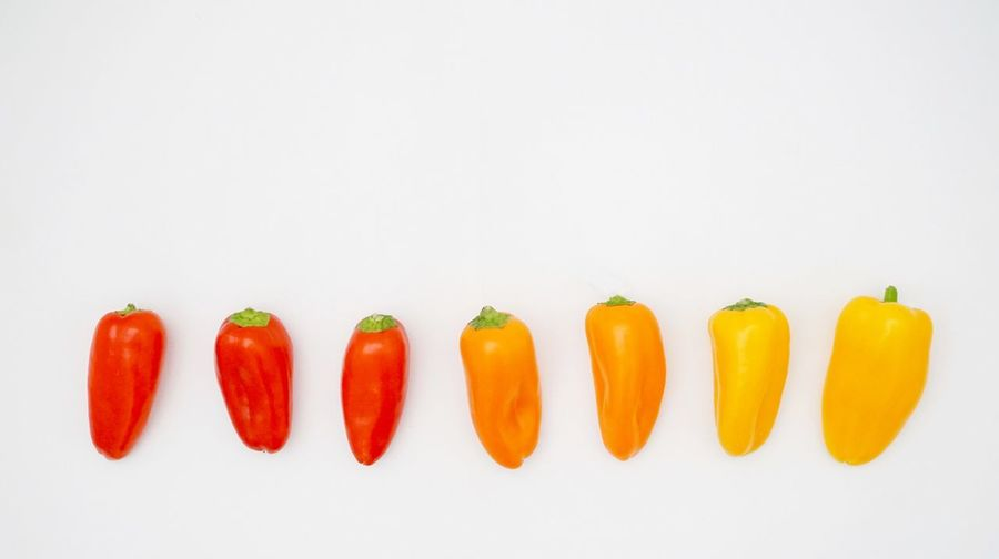 Smalll peppers Copyspace Snack Paprika Small Food Healthy Food Food And Drink Healthy Eating Vegetable Food Studio Shot Freshness Indoors  Red In A Row Pepper Side By Side Still Life Copy Space White Background Orange Color No People Group Of Objects Close-up