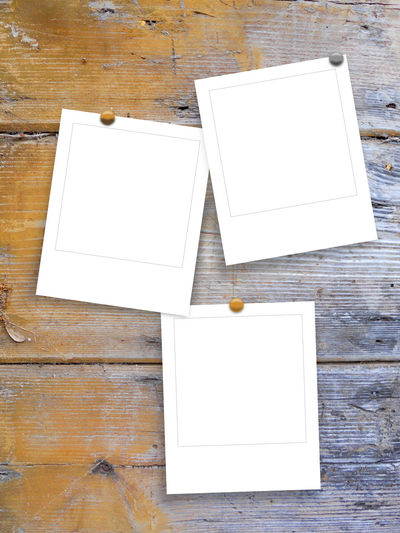 Three square frames with pins on ancient wooden board background Blue Brown Grunge Grungy Textures Indoors  Pins Polaroid Polaroids Scratched And Cracked Wood Shades Of Grey Square Frame Stains Studio Shot Three Empty Photoframes Wooden Boards Background Wooden Texture Background Yellow