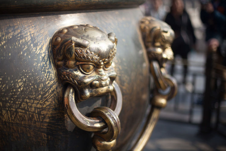 Close-Up Of Antique Metal Structure At Forbidden City