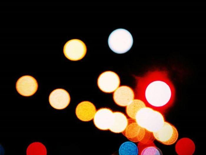 One of them is the moon Light Lights Night Unfocused Unfocusedlights Unfocusedcamera Street Trafficlights Montevideo Moon Audiovisualuruguay Nikonphotography Instalike Instagood
