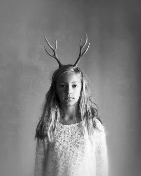 Portrait of young girl with antlers