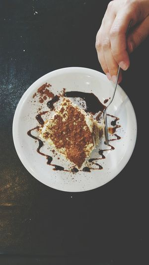 Cropped Hand Of Person Slicing Tiramisu In Spoon