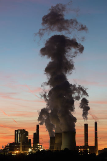 Kraftwerk RWE Power Air Pollution Atmospheric Building Exterior Built Structure Chimney Ecosystem  Emitting Environment Environmental Issues Factory Fumes Industry Nature No People Orange Color Pollution Smoke Smoke - Physical Structure Smoke Stack Sunset Umwelt