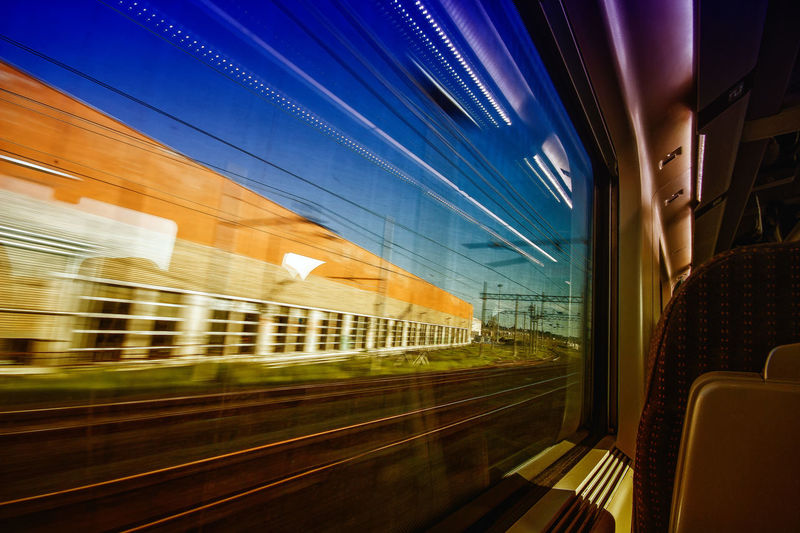 Life Velocity Blue Sky Window Train Trip Travel Traveling Travel Photography City Illuminated Architecture Sky Built Structure Train Interior Train - Vehicle Public Transportation