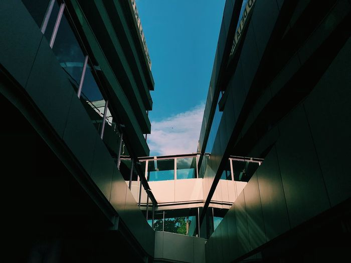 Beautiful symmertry found in an Hospital Building Architecture Built Structure Low Angle View Sky No People Building Exterior The Architect - 2018 EyeEm Awards Outdoors Building City Glass - Material Day