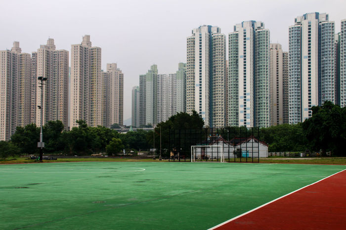 City Green Green Color HongKong Pupparazzi Red Skyscrapers Tennis Travel Photography Architecture Building Exterior Built Structure City Cityscape Eyeem Architecture Lover Football Field Modern No People Outdoors Red Color Skyscraper Soccer Soccer Field Sport Sportplatz The Graphic City The Architect - 2018 EyeEm Awards The Traveler - 2018 EyeEm Awards