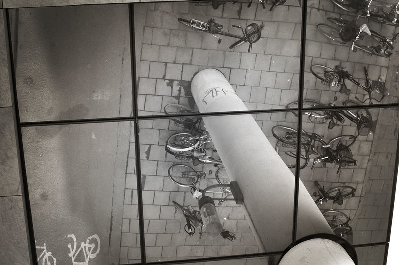 Urban bikes parked in a reflexion. Architecture Bicycle Bikes Blackandwhite Damages Dirty Mirror Monochromatic No People Parked Réflexion Upside Down Urban