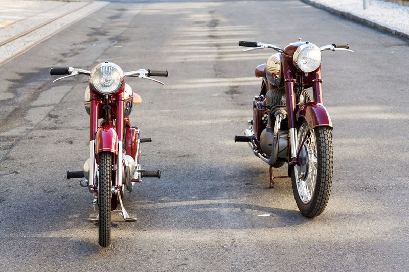 Red vintage motorcycles Jawa 125 and Jawa 500 produced in former Czechoslovakia Jawa Motorcycle Vintage Retro Red 125  500 Ohc Company Logo Motorbike Czech Republic Czechoslovakia Veteran Transportation Road Sunny Day No People Outdoors Mode Of Transportation