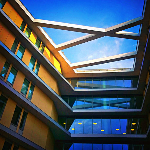 Architecture Blue Budapest Building Building Exterior Built Structure City Clear Sky College Day Hungary Kollegium Low Angle View Modern No People Outdoors Sky Sunlight Sunlight And Shadow Sunrise Window