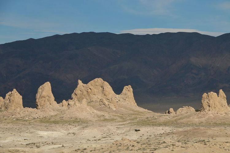 Underwater formations in dried up lake Desert Pinnacles Rock Formations Dried Up Lake Geology Landscape Mountains Sky Sunlight And Shadow Tranquil Scene Trona Pinnacles