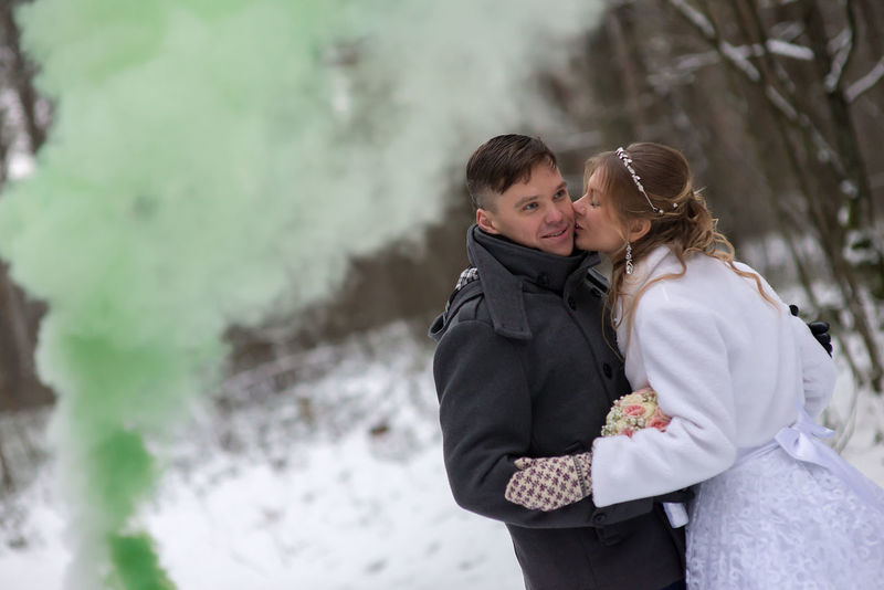 Adult Affectionate Bonding Cold Temperature Day Embracing Focus On Foreground Friendship Green Smoke Happiness Leisure Activity Lifestyles Love Nature Outdoors People Real People Standing Togetherness Two People Warm Clothing Winter Women Young Adult Young Women