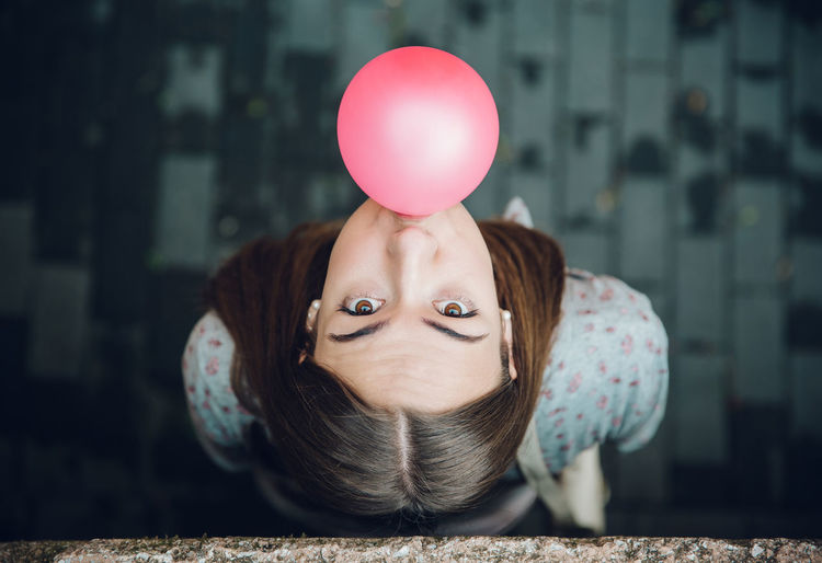 Portrait of young woman with balloons