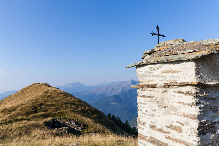 Chapel on mountain against clear sky