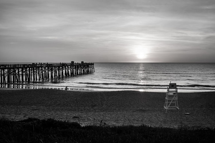 Flagler Beach, Florida Flagler Pier Beach Beauty In Nature Black And White Photography Cloud - Sky Day Florida Holiday Horizon Horizon Over Water Idyllic Land Nature Non-urban Scene Outdoors Real People Scenics - Nature Sea Sky Sunrise Tranquil Scene Tranquility Water