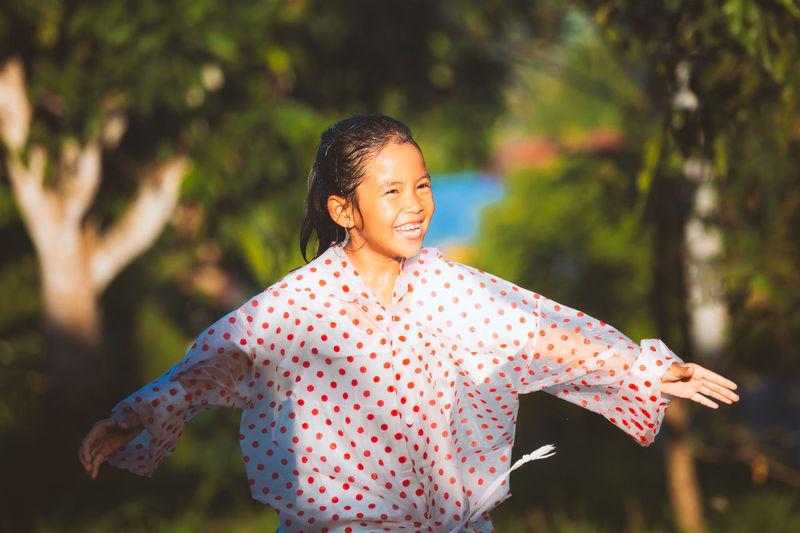Cute girl standing outdoors