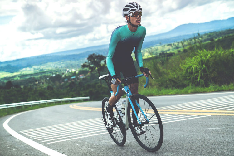 Activity Bicycle Cycling Day Full Length Headwear Helmet Land Vehicle Leisure Activity Lifestyles One Person Outdoors Real People Ride Riding Road Road Marking Sport Sports Clothing Transportation