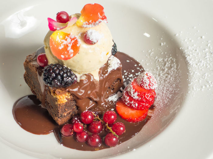 Close-Up Of Ice Cream Brownie Served In Plate