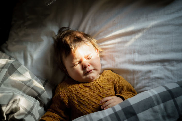 Babyboy Bed Domestic Life Innocence Sunlight Babies Of Eyeem Babies Only Bedroom Blonde Hair Childhood Cute Eyes Closed  High Angle View Indoors  Linen Lying Down Lying On Back Relaxation Resting Sheet Sleeping Son Wakeup White Linen Yellow Color
