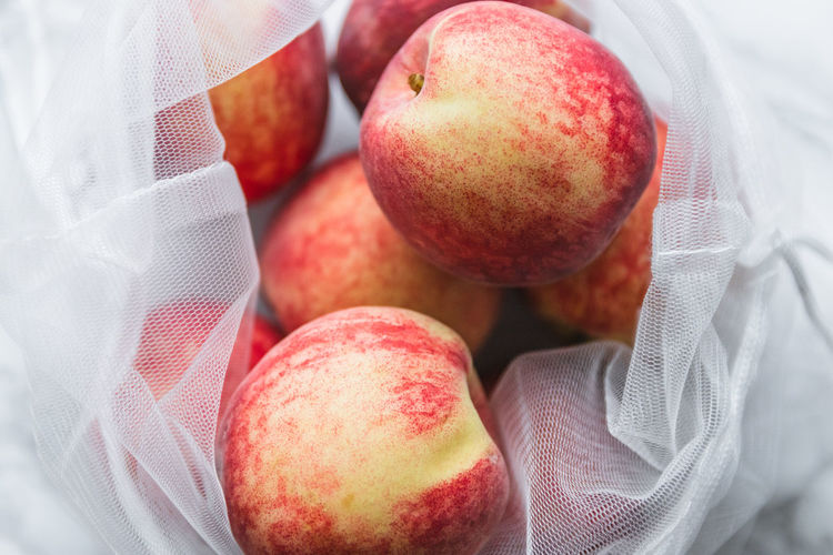 Close-up of apples in sustainable ecofriendly mesh bag