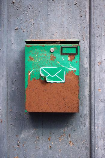 Rusty mailbox on wall