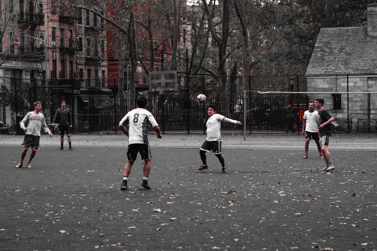 Group of people playing soccer
