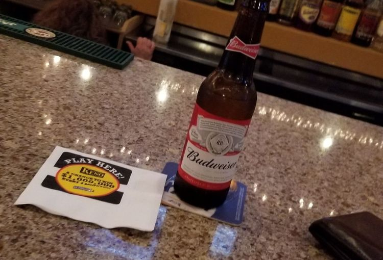 night at the bar Drinking Alone Budweiser Beer Bottle Bar Scene Communication Text Close-up Label