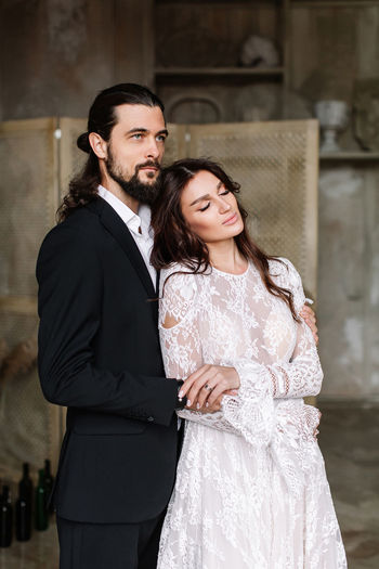Newly wed couple standing outdoors