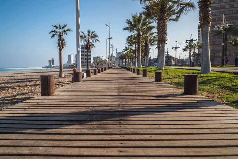 Walkpath by Simon KC Beach Beautiful Blue Boardwalk Diminishing Perspective Empty Eye4photography  EyeEm EyeEm Best Shots EyeEm Gallery EyeEm Nature Lover EyeEmBestPics Footpath In A Row Outdoors Pathway Photography Photooftheday Sky The Way Forward Tranquil Scene Tranquility Travel Vanishing Point Walkway