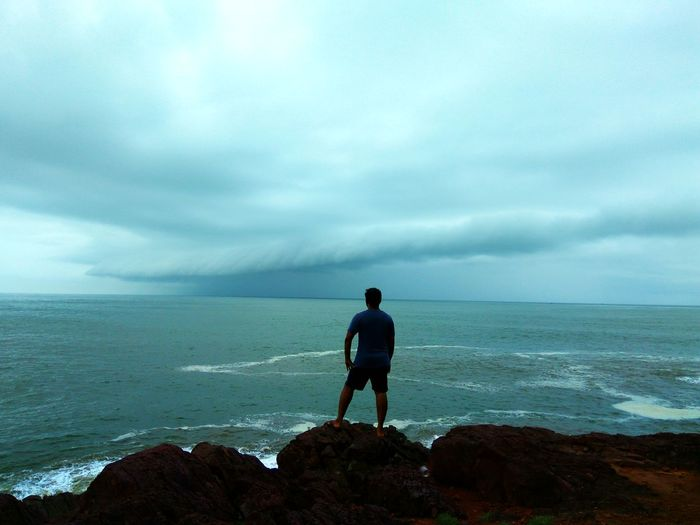 Om Beach Rain Beach Lifestyles Men Mountain Nature One Person Outdoors Sea Sea And Rain Sea And Rock Sea And Sky Sea Side Sea View Sky Standing Water