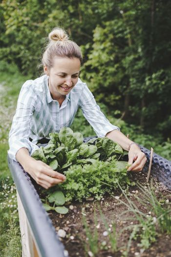 Woman holding food on plant