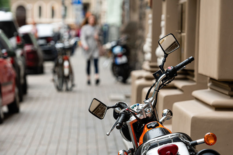 Motor cycle parked on street in city
