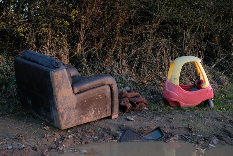 fly tipped Chair Field Fly Tipping Abandoned Childs Toy Day Leather Chair Nature One Person Outdoors People Puddle Seat Toy