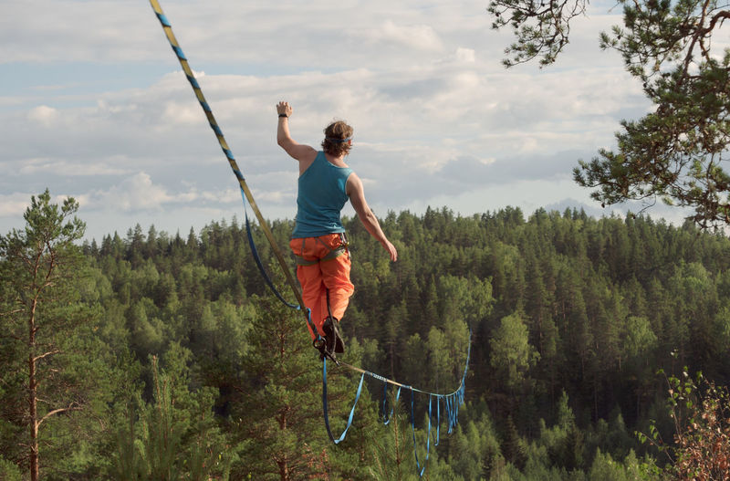 Long highline over the forest. tightrope walker