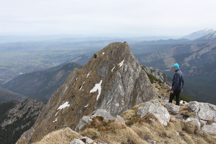 Hiker standing on giewont mountain