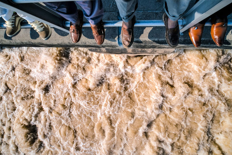Human Foot Unrecognizable Person Human Leg High Angle View Togetherness Friendship Travel Together Travel Muddy Waters River Canals And Waterways Motion Dam Agriculture Irrigation Canal Analogue Sound