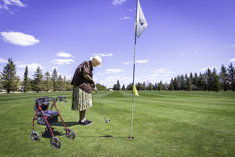 Full length of woman playing golf