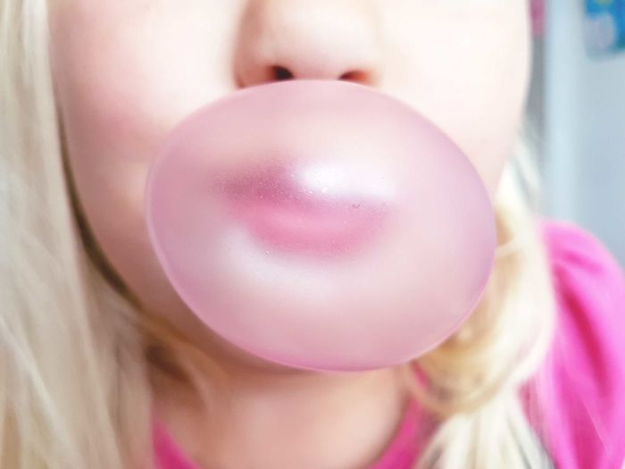 Close-Up Of Girl Blowing Bubble Gum