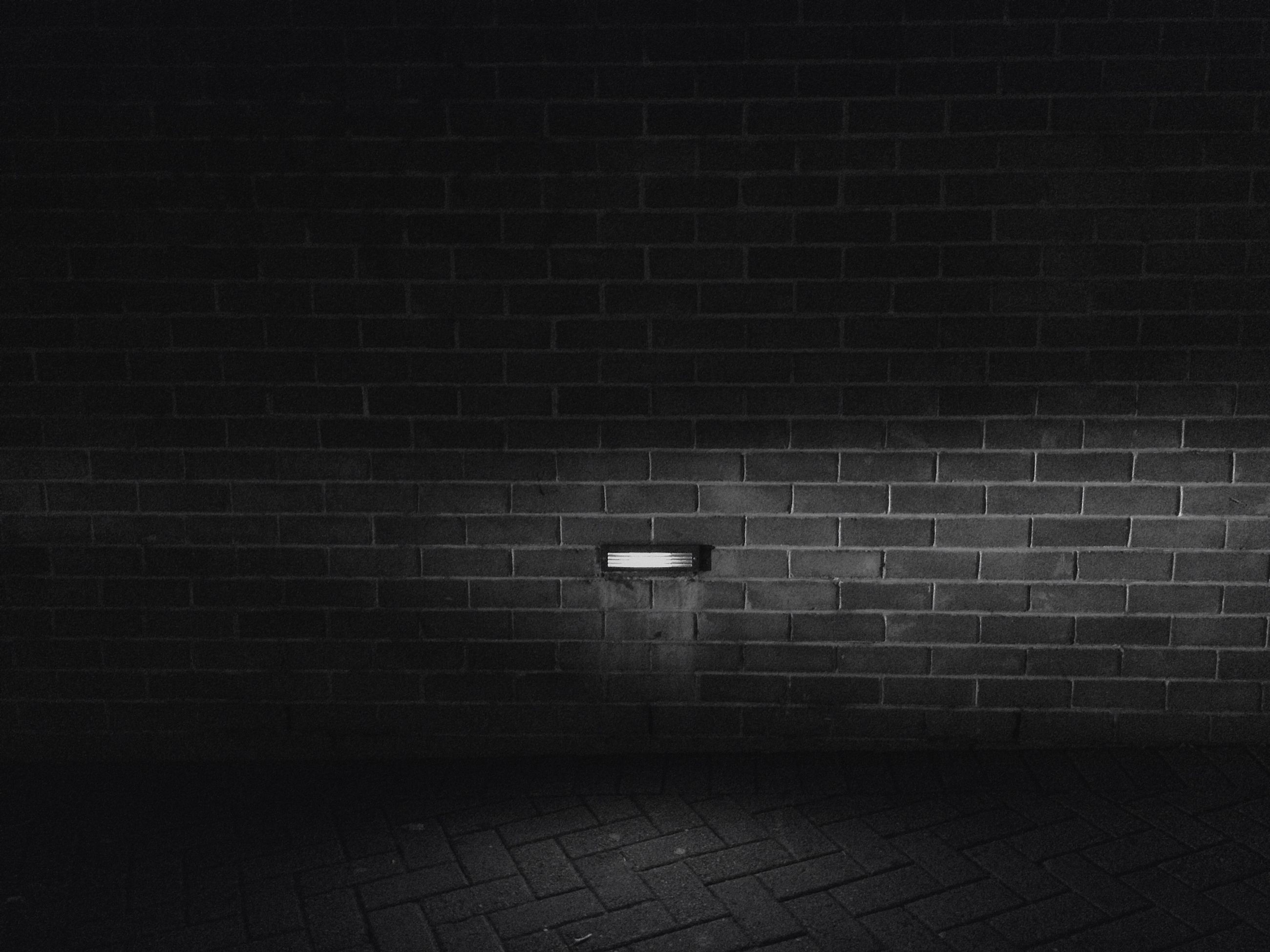 wall - building feature, built structure, architecture, night, brick wall, illuminated, building exterior, wall, no people, lighting equipment, pattern, abandoned, old, indoors, dark, high angle view, street, shadow