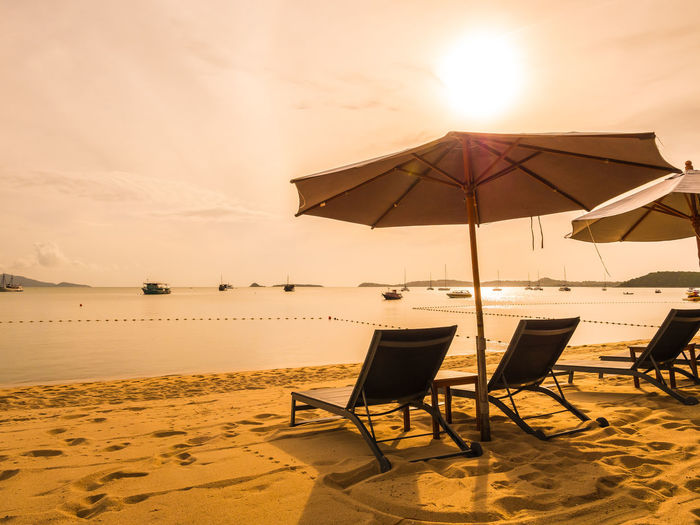 Beach Beach Umbrella Beauty In Nature Chair Foldable Horizon Over Water Land Lounge Chair Nature Outdoors Parasol Protection Sand Sea Seat Sky Sun Sunlight Sunset Trip Umbrella Vacations Water