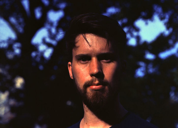 Kodak Ektar 100 The Portraitist - 2018 EyeEm Awards Beard Body Part Close-up Contemplation Facial Hair Film Photography Focus On Foreground Headshot Human Face Looking Looking At Camera Men Nature One Person Outdoors Portrait Real People Serious Tree Young Adult Young Men