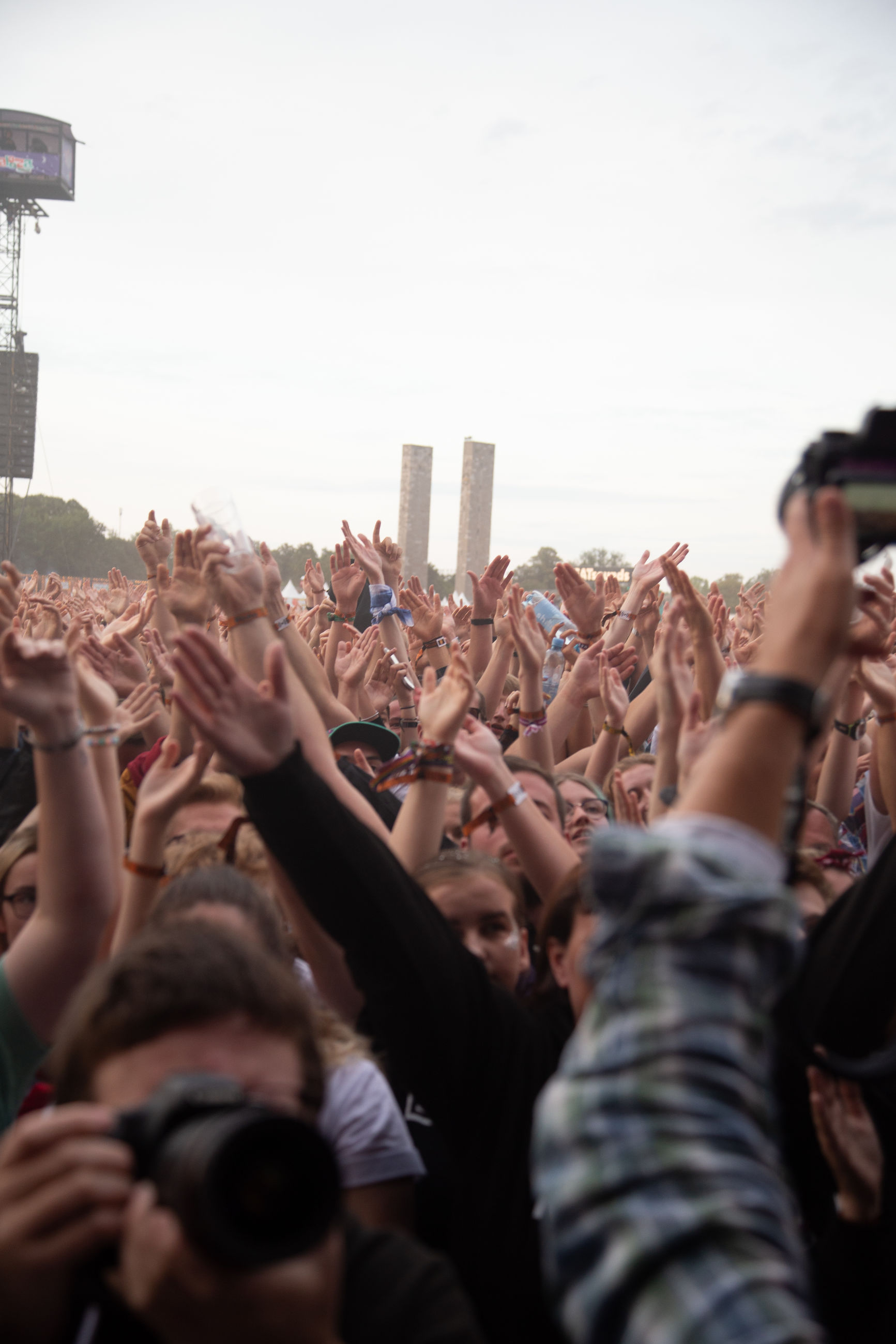 crowd, group of people, large group of people, real people, enjoyment, event, sky, women, human arm, music, arms raised, men, lifestyles, togetherness, hand, selective focus, youth culture, arts culture and entertainment, festival, excitement, music festival, outdoors, positive emotion, popular music concert, concert